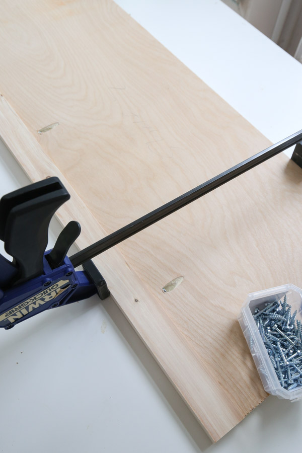 attach 1x2 trim to shelf front with drill and kreg screws
