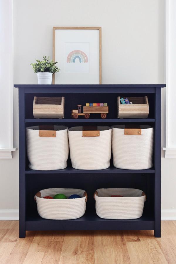 DIY kids bookshelf with storage baskets and toys