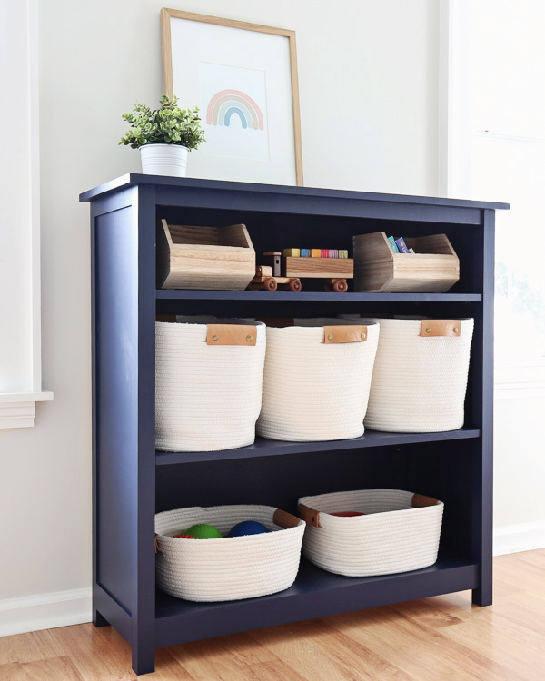 Angle view of DIY kids bookshelf with baskets