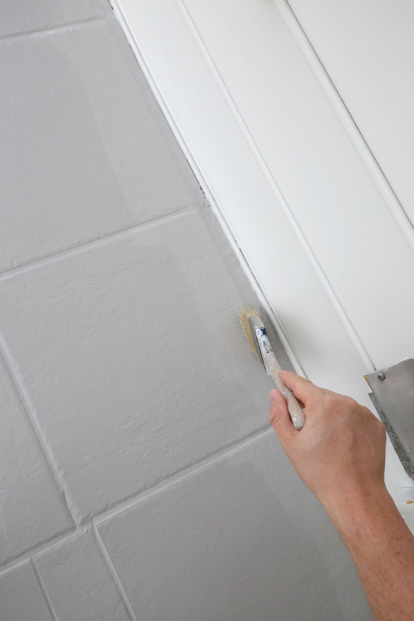 cutting in with a brush for top coat over painted tile floor