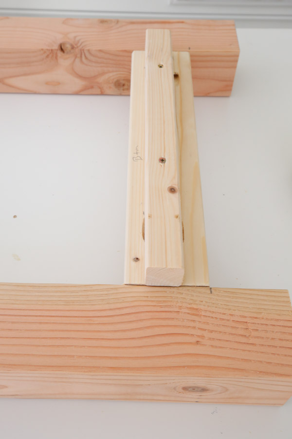 adding a 2x2 to side frames with wood screws for lower shelf support
