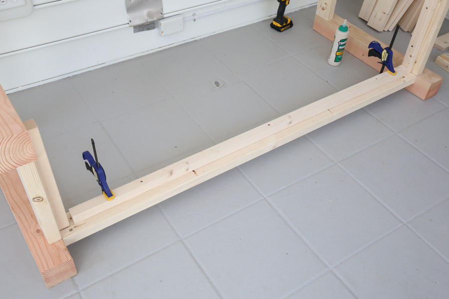 attatch 2x2 support to back frame with clamps and wood screws