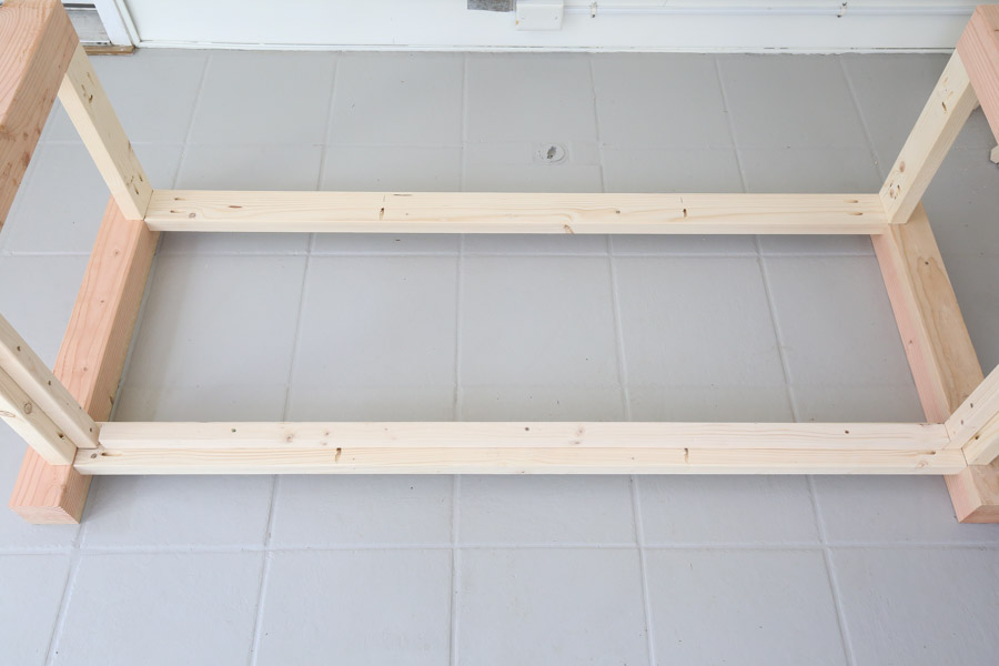 attach top back frame board to workbench sides