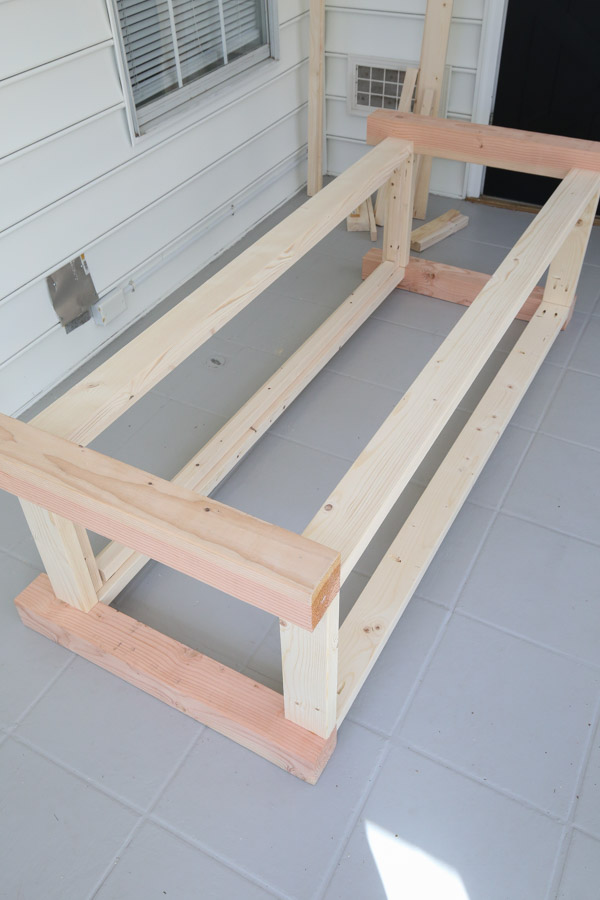 attach front frame 2x4s to workbench side frames