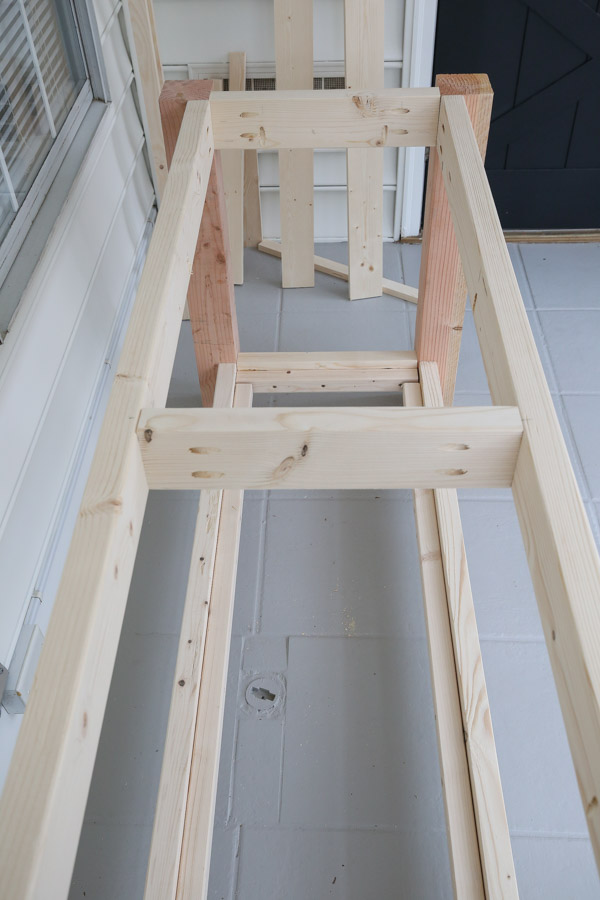 attach middle support to frame of DIY rolling workbench