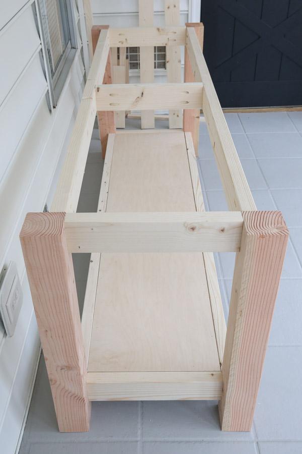 lower shelf installed on DIY workbench