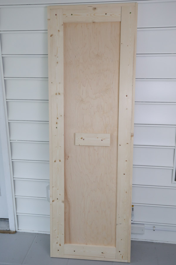 bottom view of workbench top with 1x2 trim and 1x4 bottom support boards