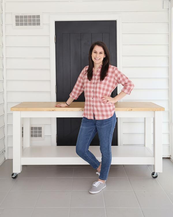 girl woodworker standing next DIY mobile workbench