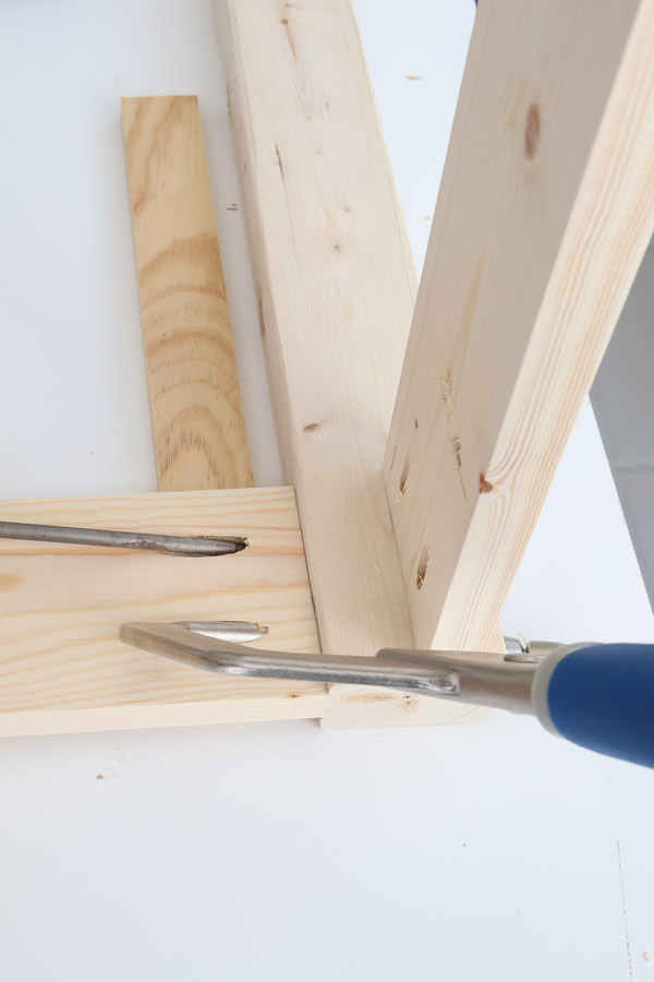 add front and back aprons to desk top with drill and Kreg screws and clamp