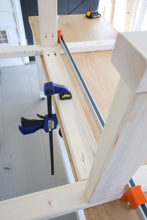 attaching back of potting bench frame with pocket holes and clamps