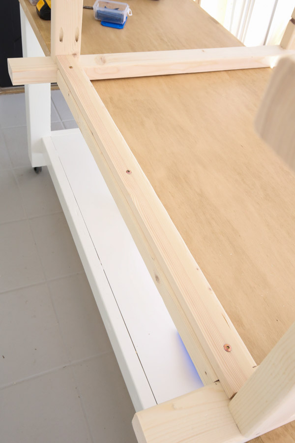 attaching 1x2 lower shelf support with screws