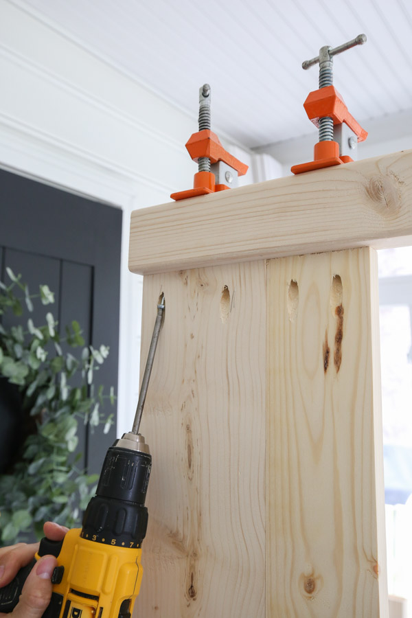 attahcing top shelf of potting bench with clamps and pocket holes