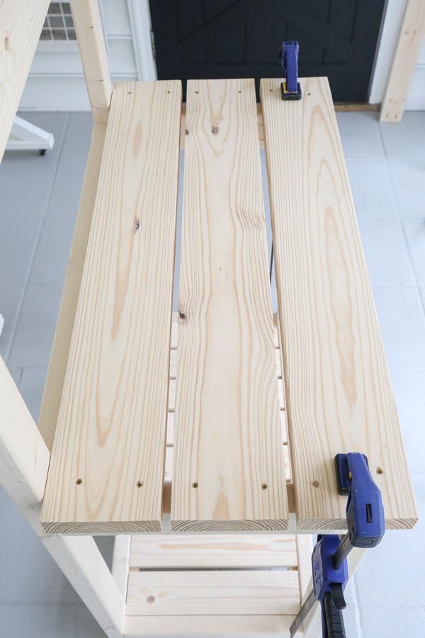 installing middle shelf of potting bench