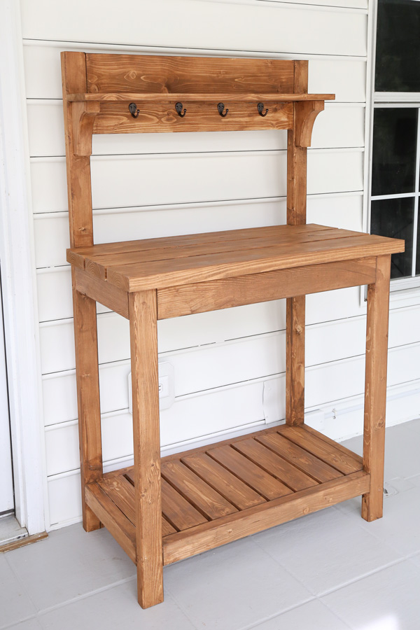 DIY potting bench after staining and building before flowers
