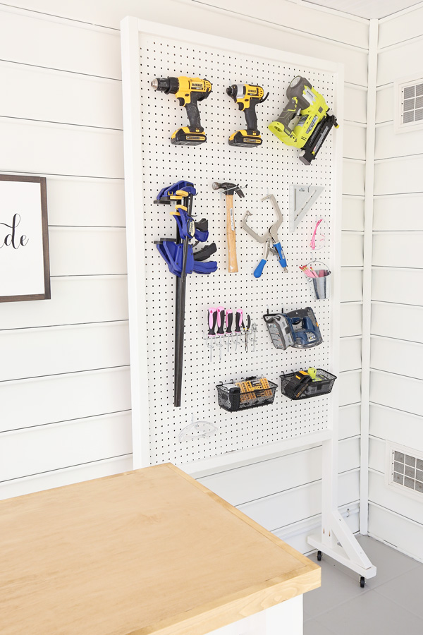 angle view of DIY pegboard stand on wheels for tools