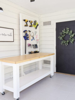 small workshop with tool organizaion and pegboard for tools and DIY workbench