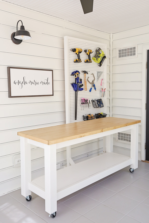 DIY workbench and DIY pegboard stand for tools in small workshop