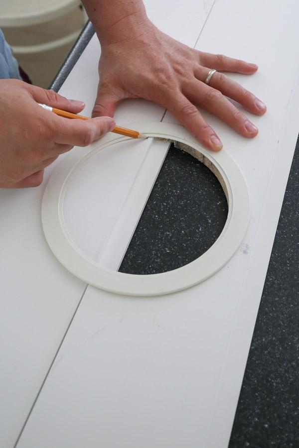tracing light hole onto shiplap board