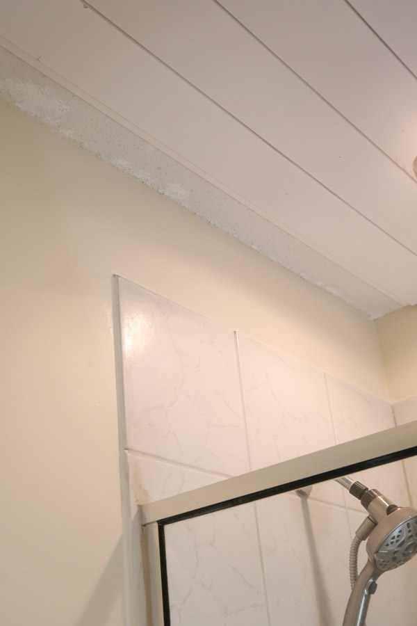 shiplap bathroom ceiling in progress with last board installation