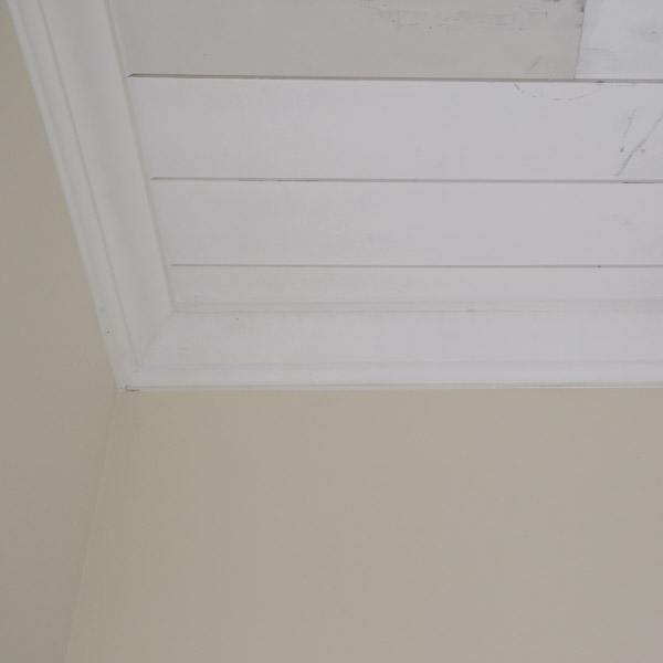 crown molding installed over shiplap ceiling edges