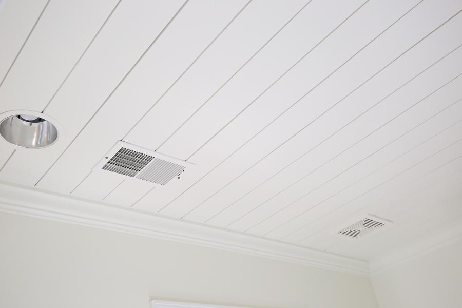 DIY shiplap ceiling with crown molding in bathroom