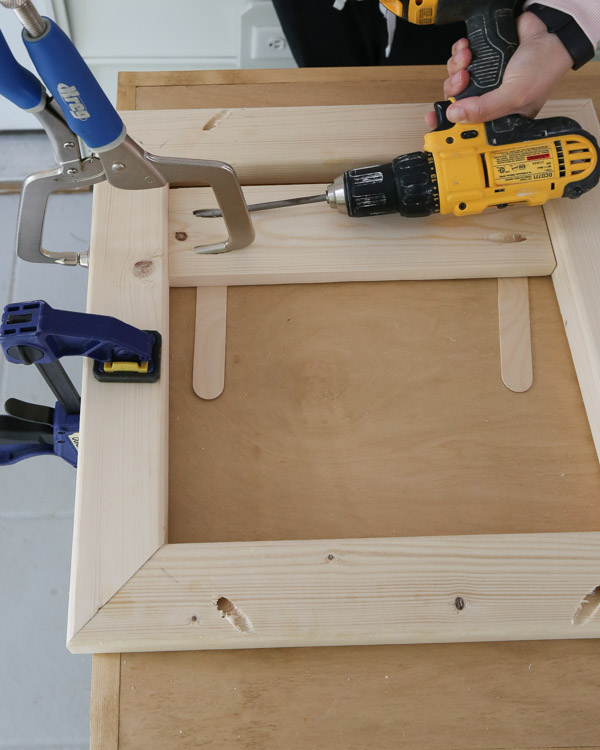 using clamps and drill and pocket holes to add slat boards to table top frame