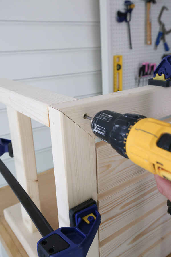 attaching the DIY outdoor side table legs to the table top frame