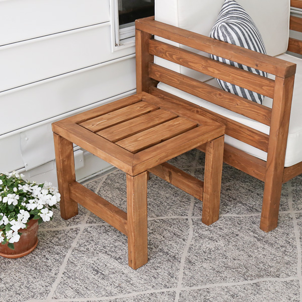 DIY outdoor side table next to matching DIY outdoor furniture