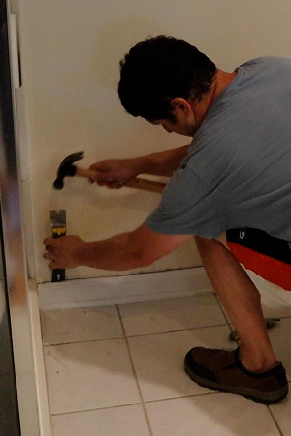 remove the baseboards with a prybar and hammer