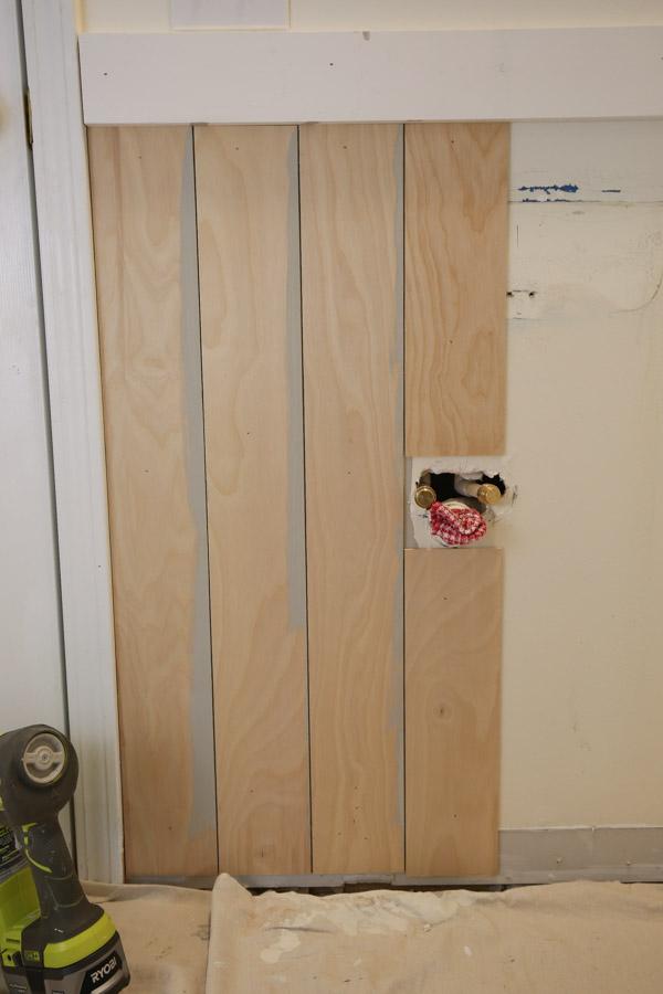 vertical shiplap bathroom installation