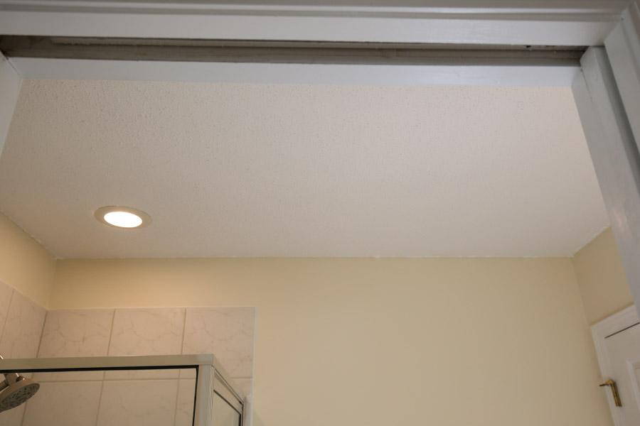 popcorn ceiling before bathroom makeover