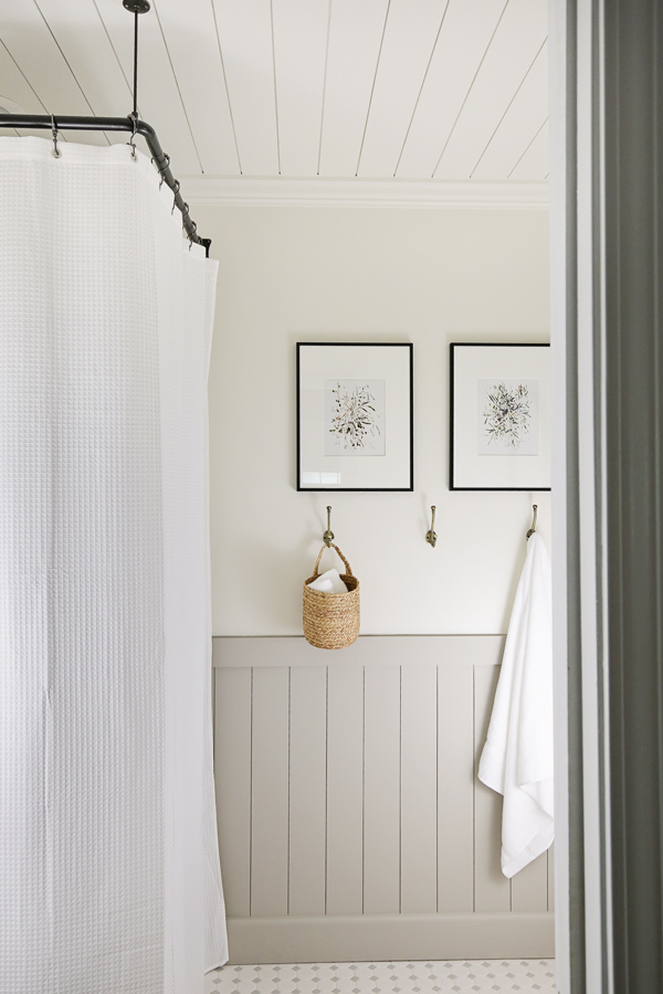 pretty corner shower curtain and rod with DIY vertical shiplap in bathroom makeover