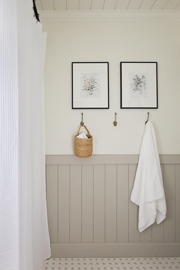 DIY vertical shiplap and art in bathroom makeover