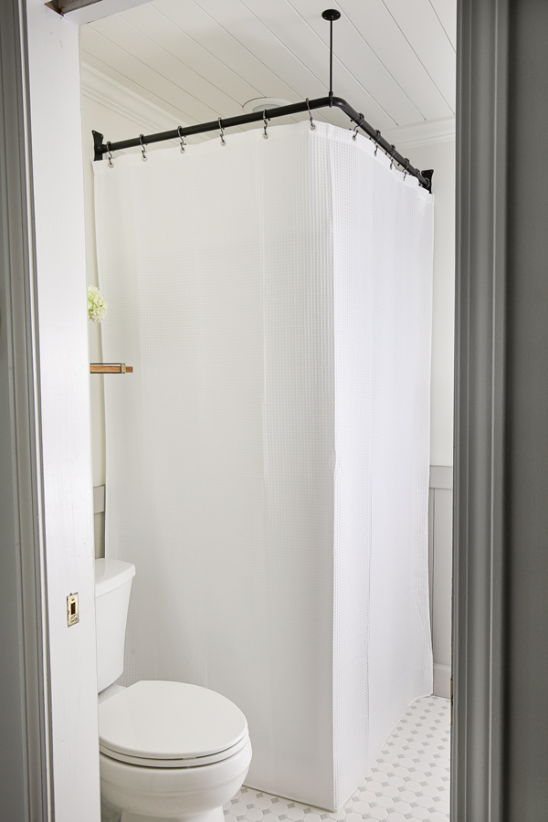 how to hide a corner shower with an extra long shower curtain