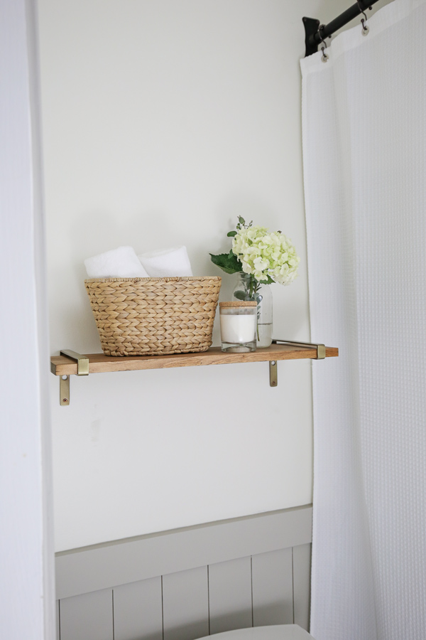 floating wood shelf with modern brass shelf brackets