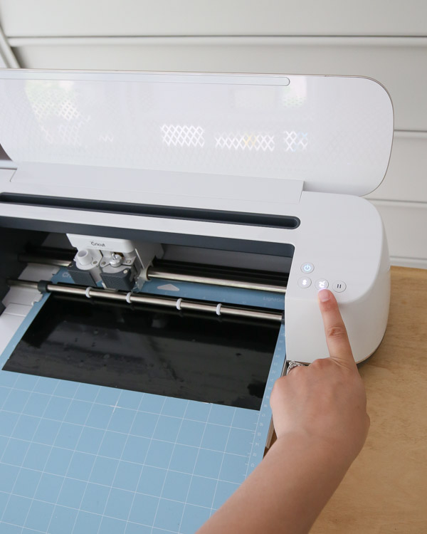 Press go button on Cricut Maker