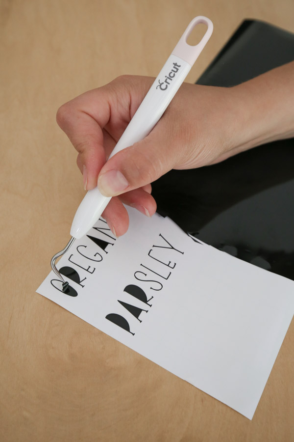 weeding the vinyl for the Cricut labels