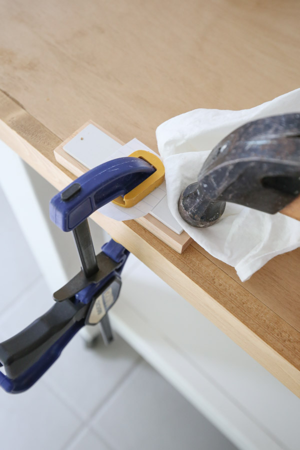 using a hammer and nails to attach the boards together