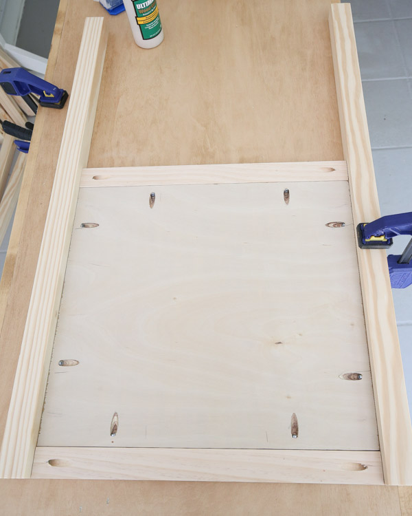 attach legs to side frame with clamps