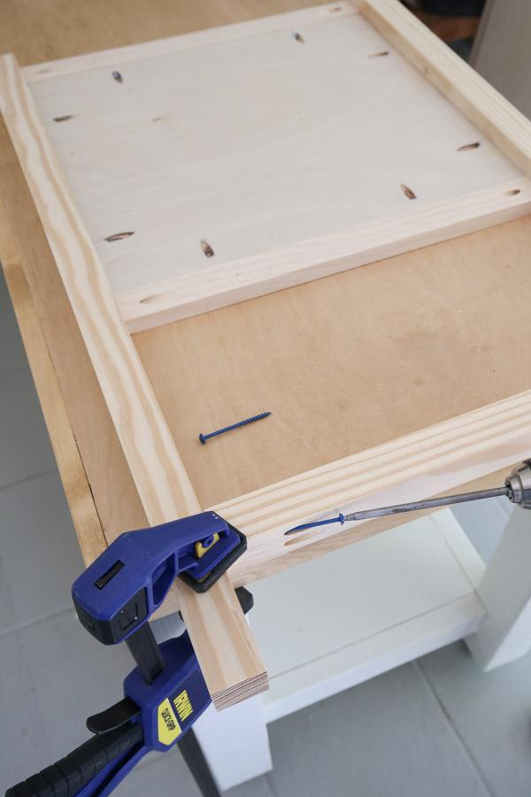 attach 2x2 for lower shelf frame to side frame