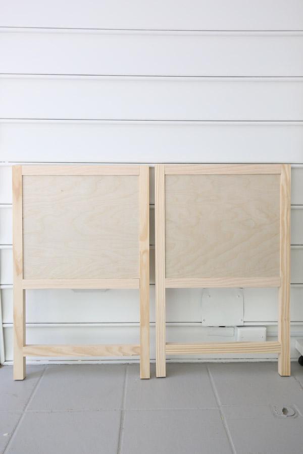 two DIY bathroom vanity side frames front view