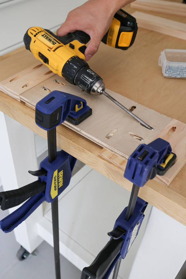 attaching DIY bathroom vanity door together with kreg screws and drill