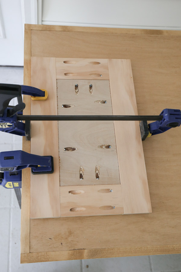 attaching DIY small bathroom vanity door together with kreg screws and drill