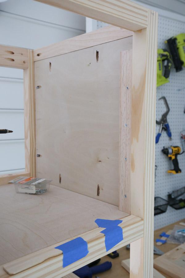 adding 1x2 for door hinge install
