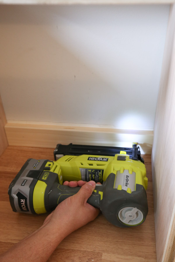 adding trim over pocket holes on bench top frame with brad nailer