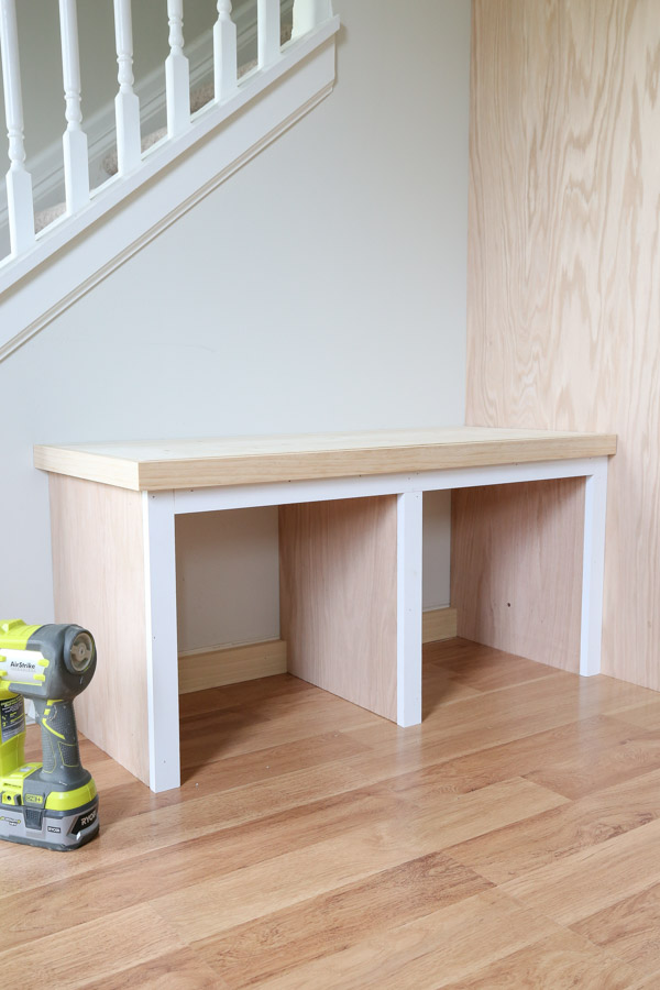 trim added to DIY built in bench with brad nailer and wood glue