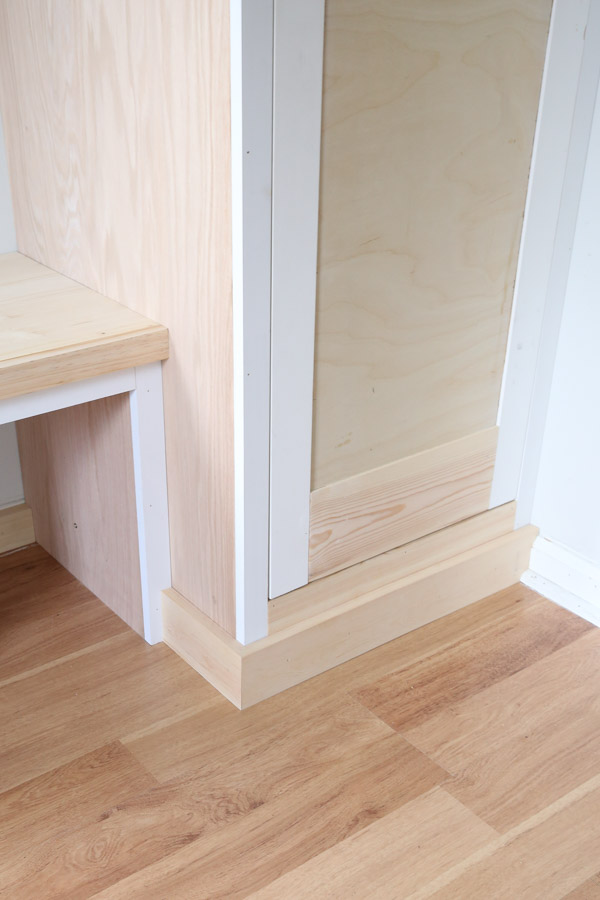 1x4 trim wrapped around DIY built in cabinet and DIY built in bench