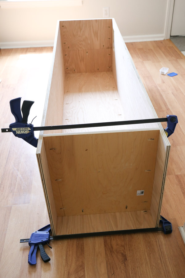 adding bottom board to DIY built in cabinet frame