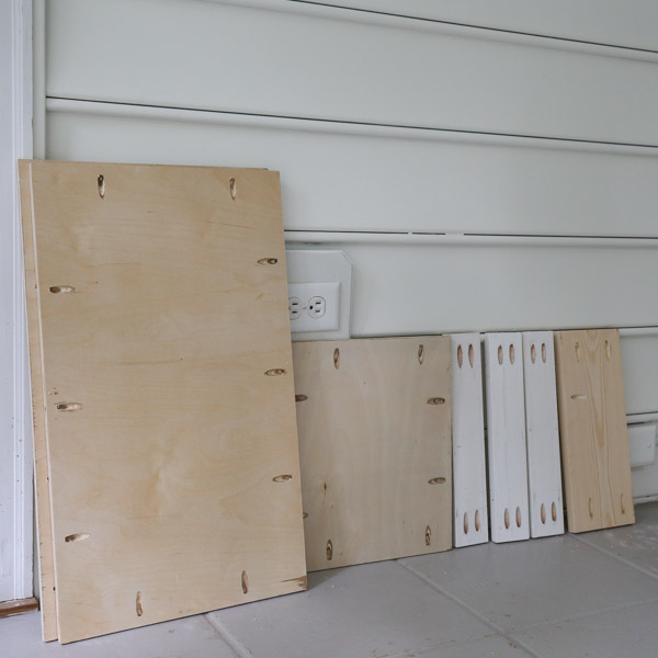 pocket holes drilled on cabinet door plywood boards