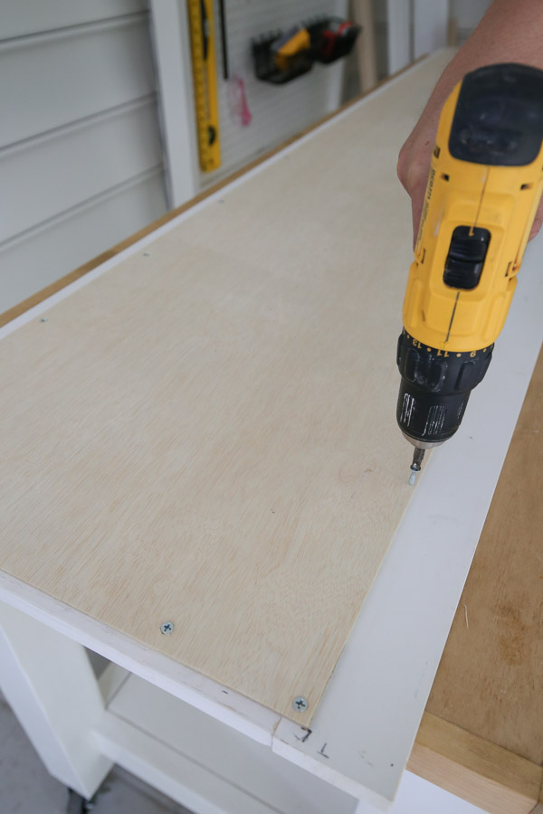 """adding 1/4"""" plywood to back of cabinet door with screws and drill"""